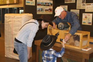 If your fair has a Texas Farm Bureau booth, be sure to stop by! This family is learning about our mini cotton gin.