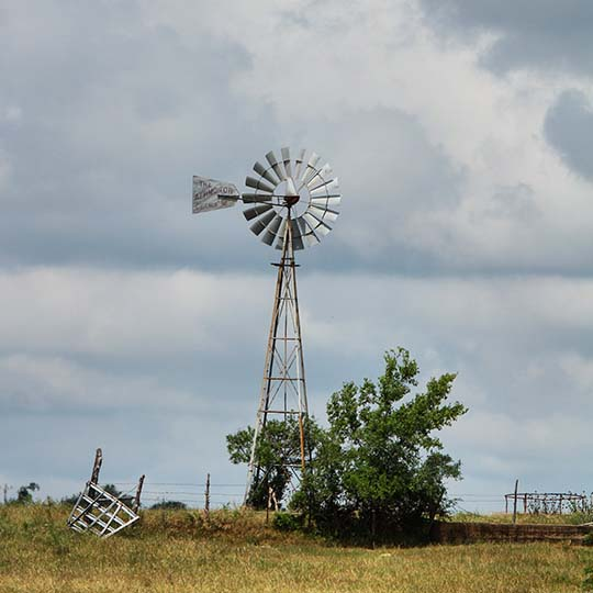 Windmills and clouds. It's a Texas scene.