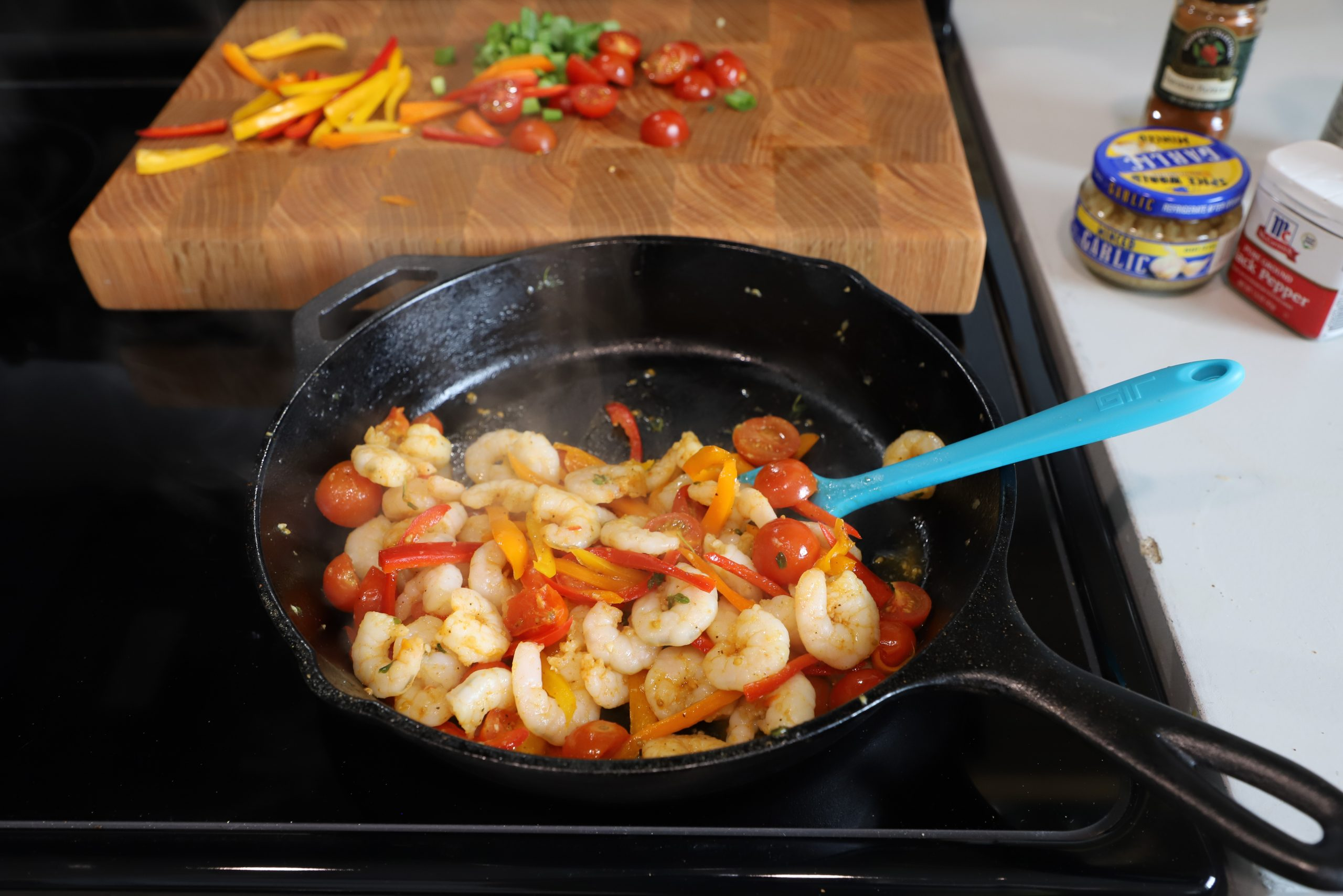 shrimp in cast iron skillet with vegetables